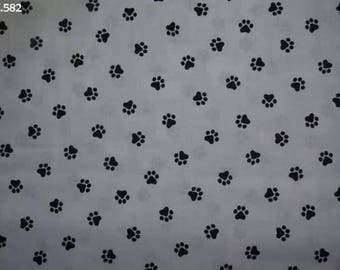 Fabric C582 paws black dogs on white coupon 50x50cm