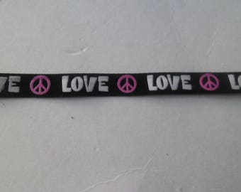 LOVE x 1 metre of black satin ribbon in white with 10 mm peace sign