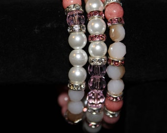 Pink and white elastic bracelet set