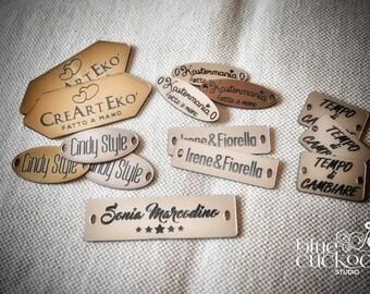 100 custom plastic tags (looks like metal), laser cut and engraved
