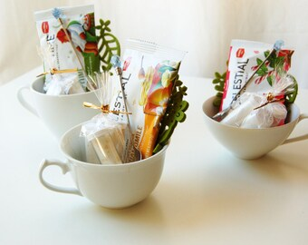 Mom's Relaxing Tea Cup Gift Set: 3 herbal teabags, 3 sugars, 1 felt coaster, 1 jeweled stir spoon all in a white teacup, Mother's Day Gift