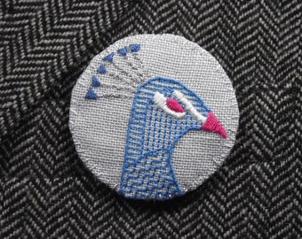 M. Peacock grand Badge