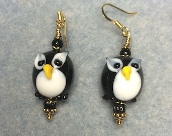 Black and white lampwork owl bead dangle earrings adorned with black Czech glass beads.