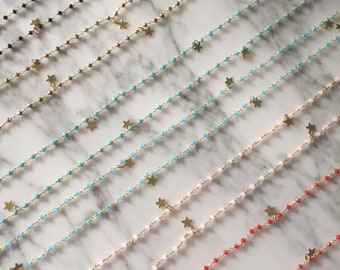 Long rosary with golden stars. BASIC Collection