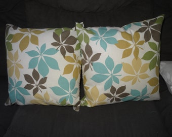 Neutral colored flower pillows