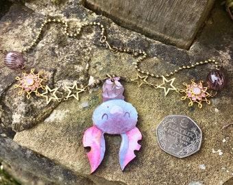 Hanging, whimsical bat pendant necklace, pink, woodcut, laser cut