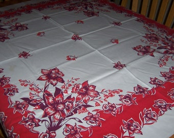 Vintage tablecloth with red daffodils
