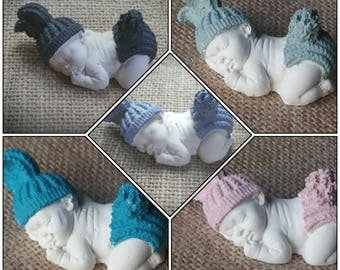 Decoration baby sleeping in plaster hand painted different colors