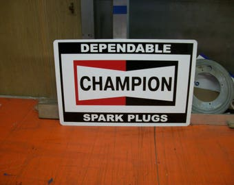 Champion spark plugs metal sign 18x12 inch