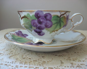 Lefton Hand Painted / Footed China Teacup and Saucer, White China, Gold Trim, Purple Grapes, Green Leaves,Vintage Teacup and Saucer