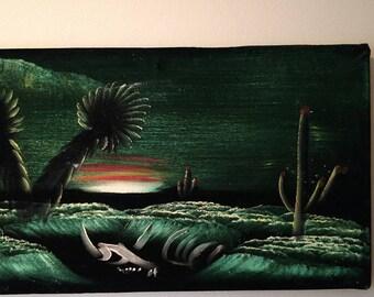 Vintage black velvet painting perfect desert sunset with skull