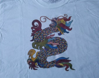 Rainbow color Dragon printed on white 100% cotton t-shirt. Original art is by Claire Decker and copyright protected.