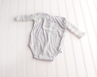 Head Turner - newborn long sleeve body suit romper in a grey knit with grey and white heather sweater sleeves and pocket