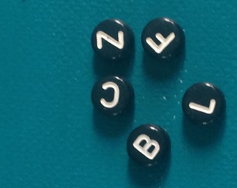 black and white letter bead