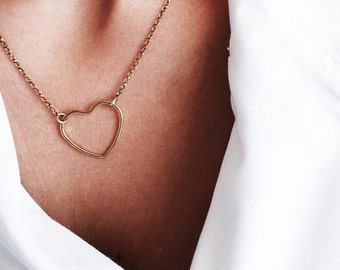 Necklace with an open heart pendant in silver and gold