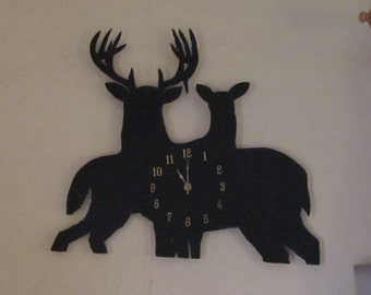 Metal Art Wall mounted Deer clock - Portrays a buck and a doe with a clock mounted in the middle