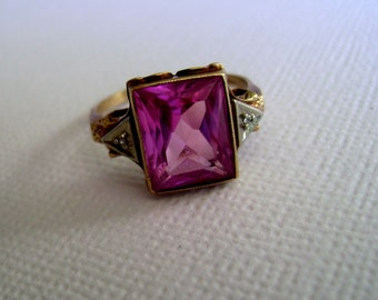 10k gold and synthetic pink sapphire ring with tiny diamonds, size 7