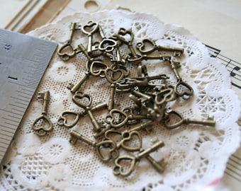 20 Tiny Antique Bronze Heart Keys with Loop