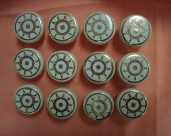 Set of vintage 12 matching 1940 1950 white and gold star type design round Porcelain Knobs art craft decorate fun old