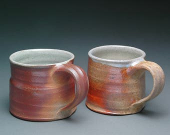 Pair of Wood Fired Coffee or Tea Mugs with Nice Ash Collection and Pale Blue Liner Glaze