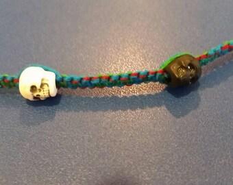 Black and White Skulls on Jewel-Tone Cord bracelet