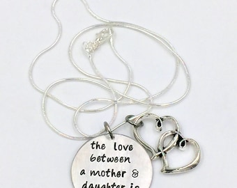 CLEARANCE - The love between a mother and daughter is forever Hand Stamped Silver Necklace
