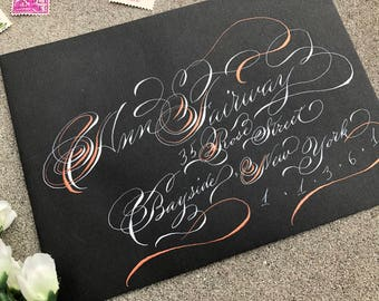 Two-tone WOW calligraphy envelopes in white and copper on black envelopes in art nouveau script. Bespoke custom calligraphy envelopes.