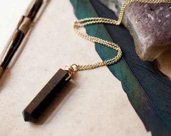 Nuummite and 14k gold fill necklace, gemstone point. wire wrapped, Magickal talisman, mineral amulet, Sorcerers Stone.