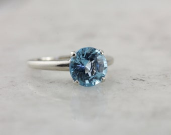 October Sky Engagement: Brilliant Round Blue Topaz Solitaire Ring  PKTF4T-R