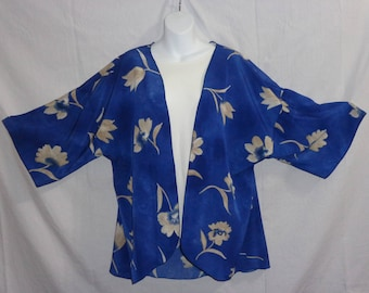These beautiful Kimono Jackets will add a splash of excitement and elegance to many outfits.  Royal Blue Ivory Flower, Black White Paisley.