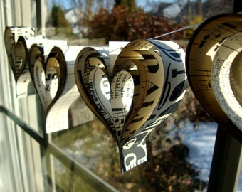 Love paperie   a garland of hand cut hearts