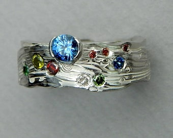 Sapphires  and colored diamonds set in a 14 kt white gold and sterling silver Mokume-gane band