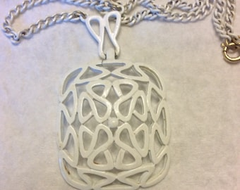 Vintage 1950's enamel on metal scroll work white pendant necklace .
