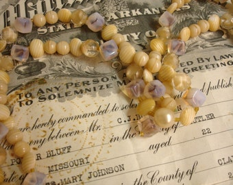 """52"""" assorted vintage glass beads coordinating glass beads assorted shapes and sizes shades of latte and caramel temporarily strung"""
