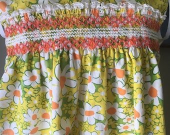 Vintage flower power hand smocked dress with pockets and eyelet trim