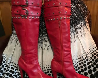 Vintage red faux leather over the knee boots.