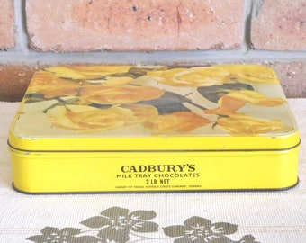 Cadbury's Milk Tray Chocolates vintage 1960s square metal tin with yellow rose design, advertising, hinged lid, collectable, movie prop