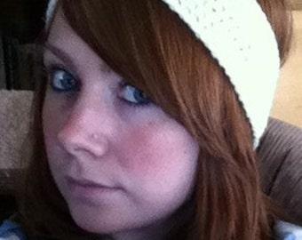 Crocheted beige headband.
