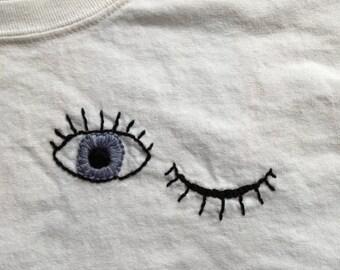 Open Closed Eyes Emblem Shirt