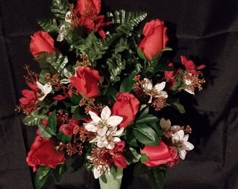Christmas Funeral Arrangement made with Mini Poinsettias and red Roses