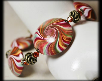 Morocco... Handmade Jewelry Bracelet Beaded Antique Brass Polymer Clay Beads Crystal Swirl Spiral Wine Magenta Burgundy Forest Green Gold