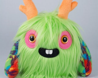 Melon the MonsterFriend unique furry monster plush lime green fur with orange antlers, big smile, tie-dye arms