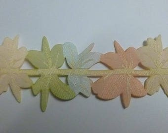 Fusible tape with various flowers in pastel colors