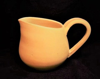 Yellow heavy pottery pitcher