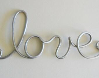 Word sculpture in aluminum-Medium words