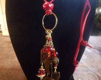 red and gold bird & kitty charm necklace