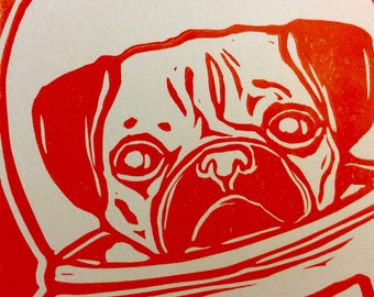Pug in a spacesuit (original block print, orange ink on cream cardstock)