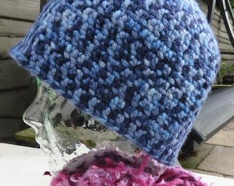 Crochet beanie hat in variegated blues