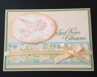 Sent from heaven ~ stork with baby