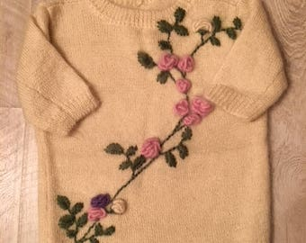 Warm sweater with floral embroidery